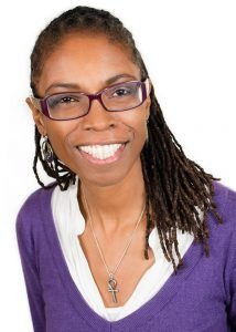 Ntathu Allen A smiling Black Woman wearing glasses